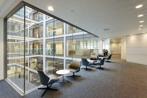Waiting chairs next to office interior atrium
