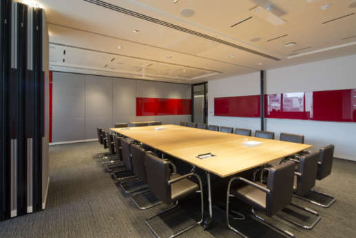 Modular boardroom with red accents