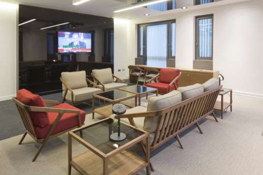 Office reception with comfortable arm chairs