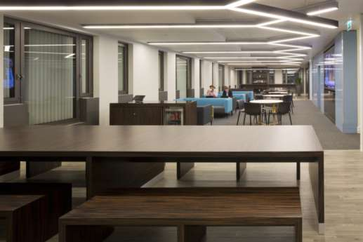Communal benches in staff cafeteria / modern office