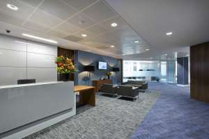 Open plan office reception with blue walls