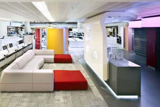 Comfy sofas next to workstations in modern office fit out