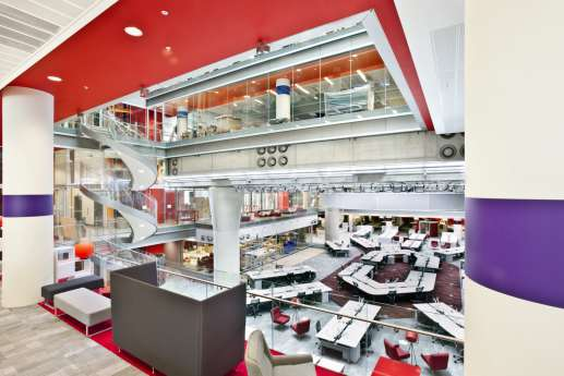 View of spiral staircase and workstations in open plan office fit out