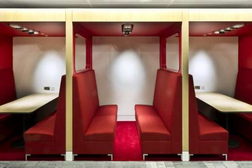 Red booth seating in modern office fit out