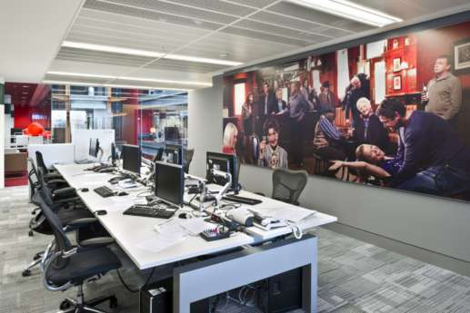 Workstations and large wall print in modern office