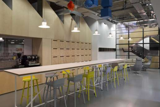 Office kitchen with coloured chairs
