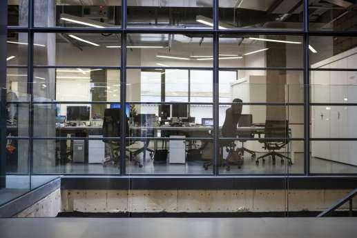 Viewing boardroom through loft-style atrium