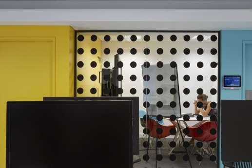 Polka dot glass-walled meeting room