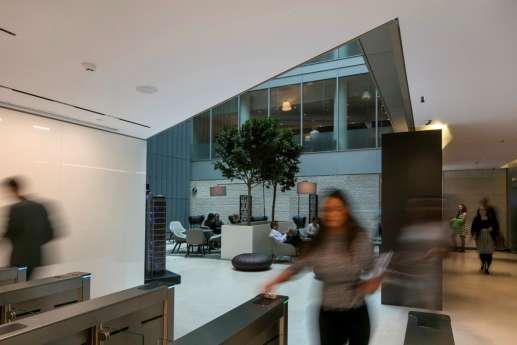 Staff moving around atrium in modern London office fit out
