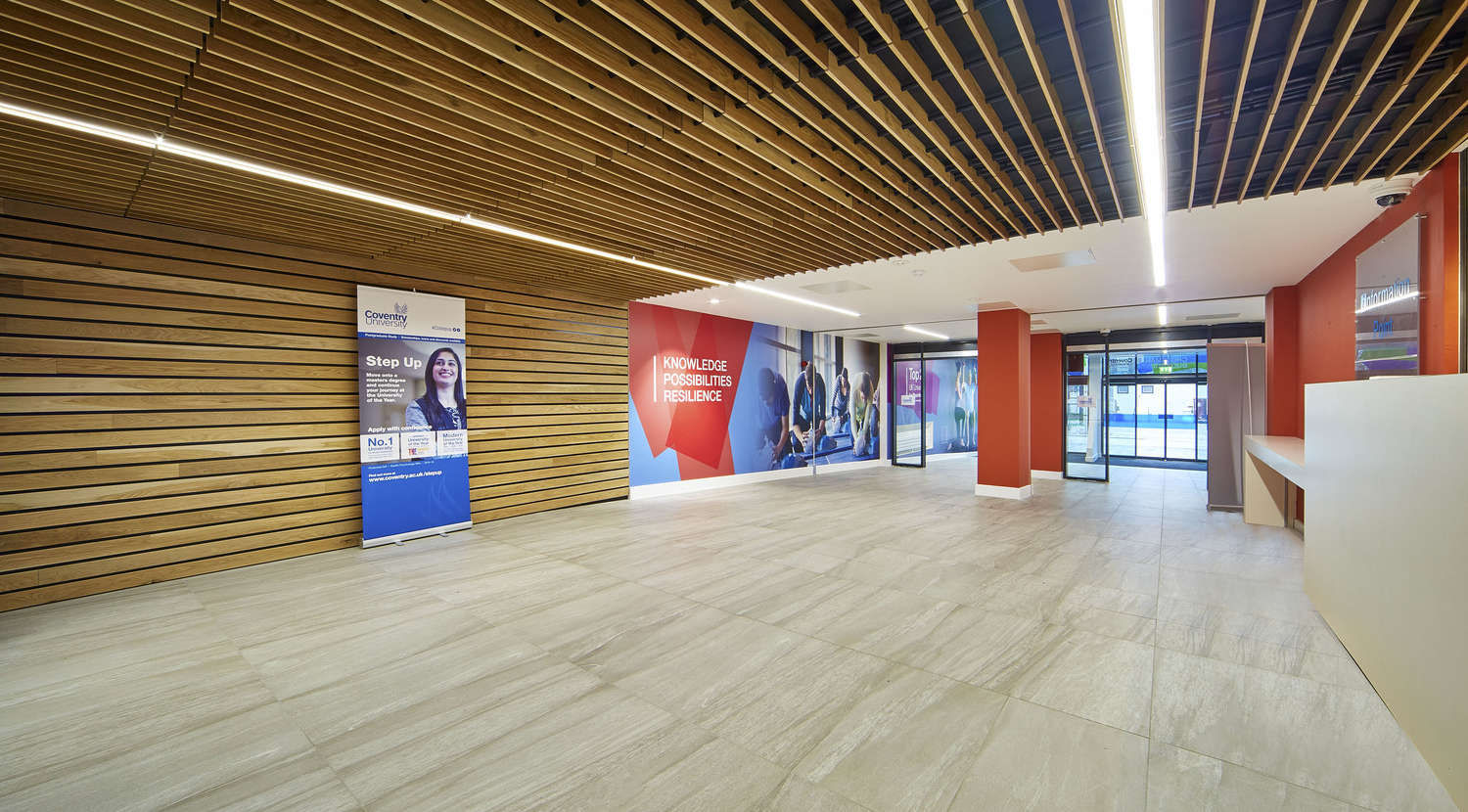 Modern office reception with wooden paneling