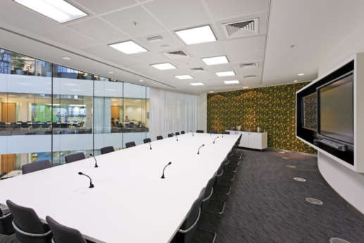 Boardroom with modern wallpaper and views into the office