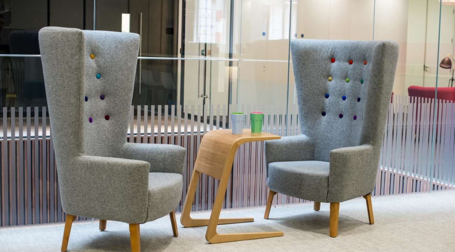 Colourful armchairs for impromptu meetings in modern london office fit out