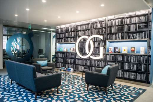 Waiting area with full-size bookshelf in stylish office fit out
