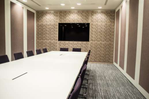 Boardroom with textured walls and carpets in london office fit out