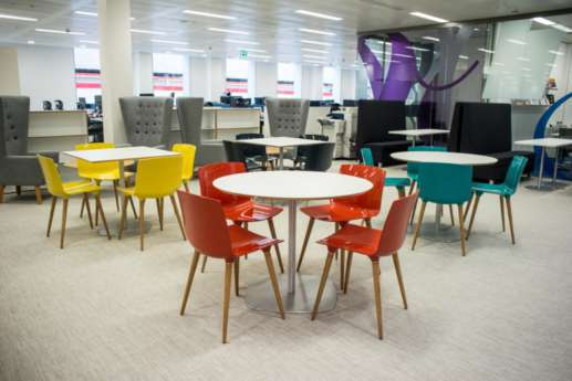 Brightly coloured chairs in staff breakout area