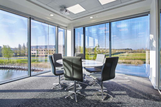 Floor to ceiling windows frame views over the Cambridge countryside