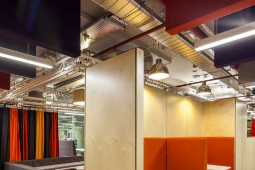 Modern and industrial fit out with wood paneling and exposed services