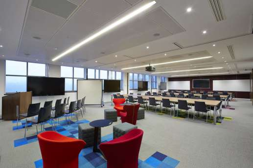 Auditorium with coloured seats in large Warwick office fit out