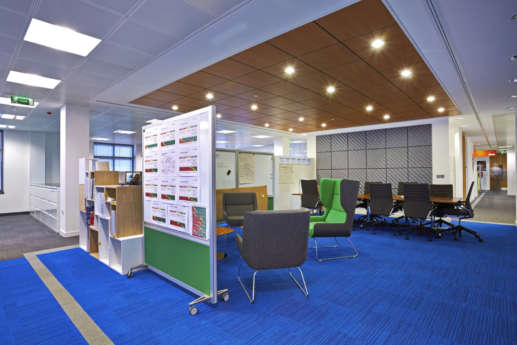 Bright coloured seating and flooring in funky office fit out