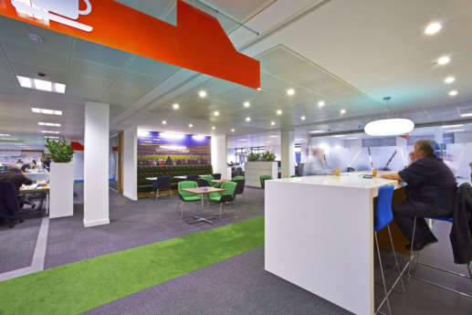 Staff breakout area with colour-coordinated flooring and office funiture