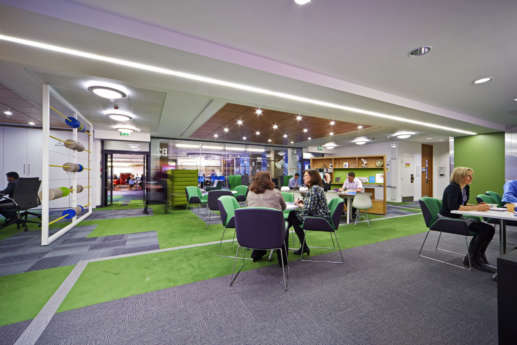 Staff in funky coloured breakout area in Warwick office fit out