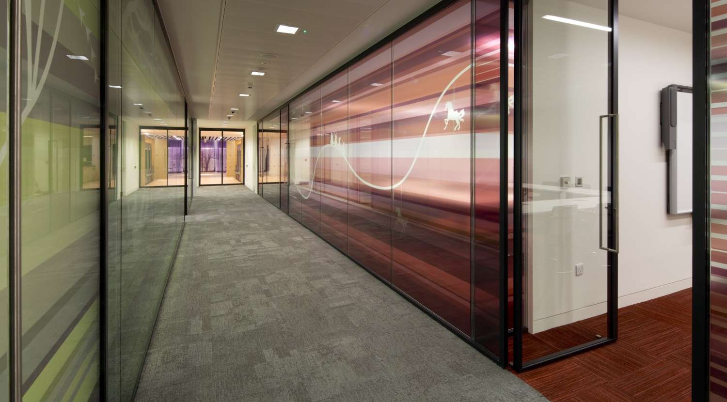 Meeting rooms with colourful wall detailing in London office fit out