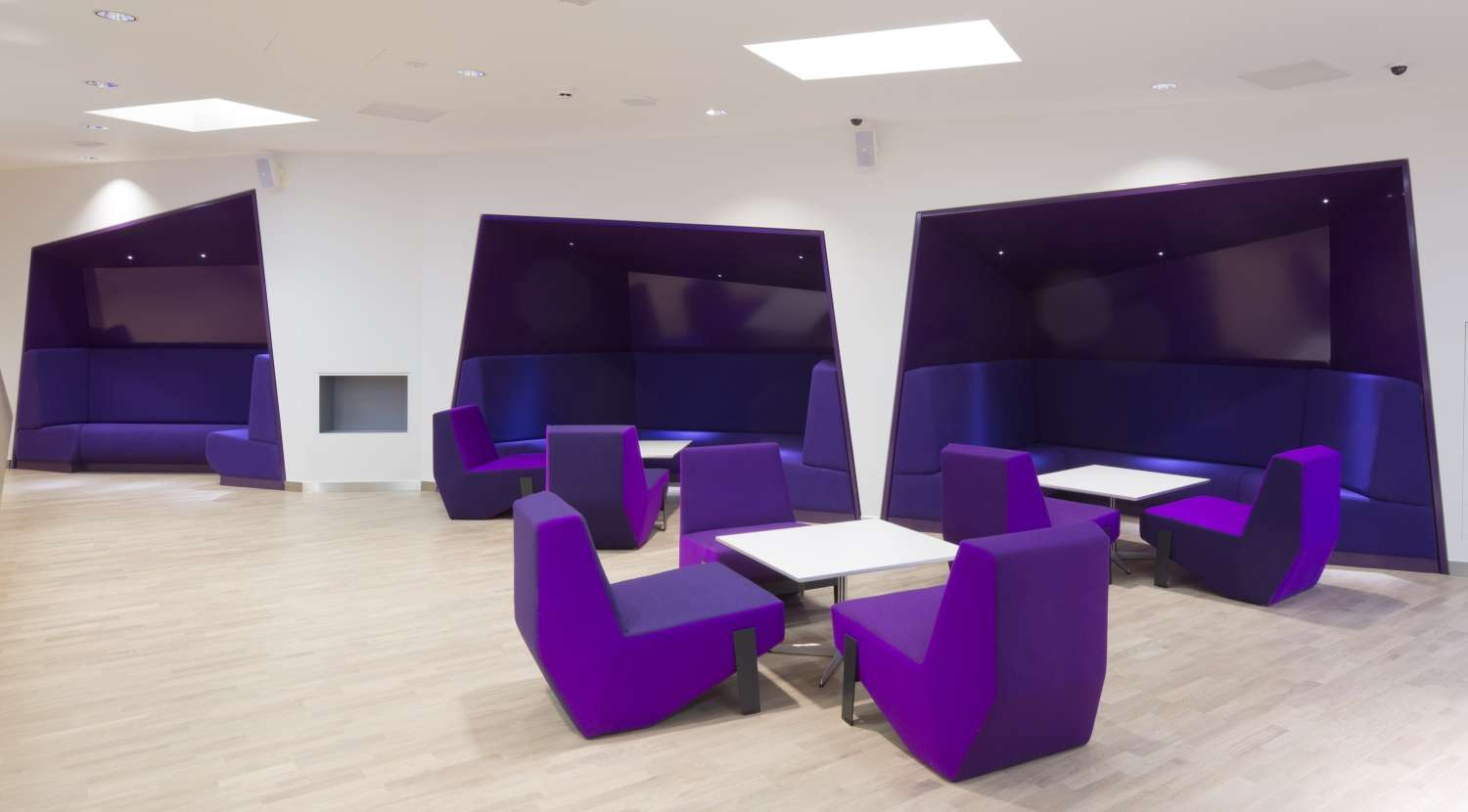 Bright white and purple modern seating in London office fit out