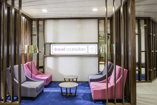 Reception area with wood paneling and coloured chairs