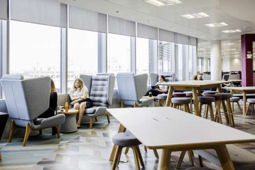 Staff talking in private chairs in a office fit out breakout area