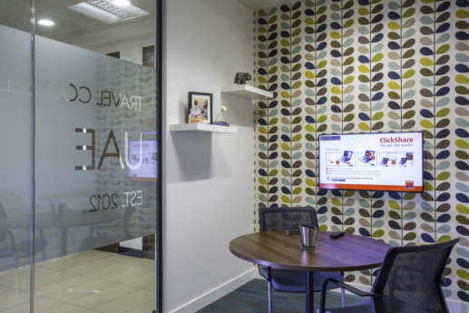 Cosy meeting room with TV and retro wallpaper