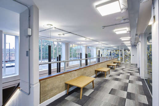Tables looking over office atrium
