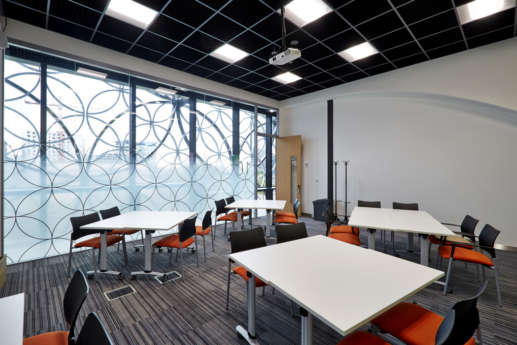 Bright classroom with glass wall in Birmingham