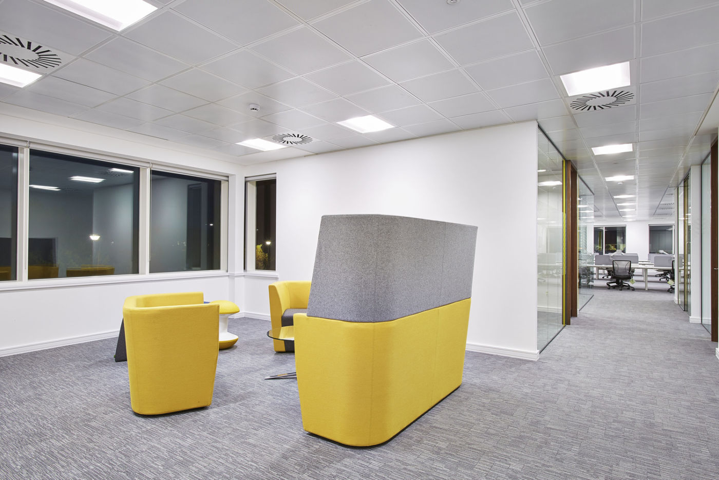Office fit out with yellow furniture
