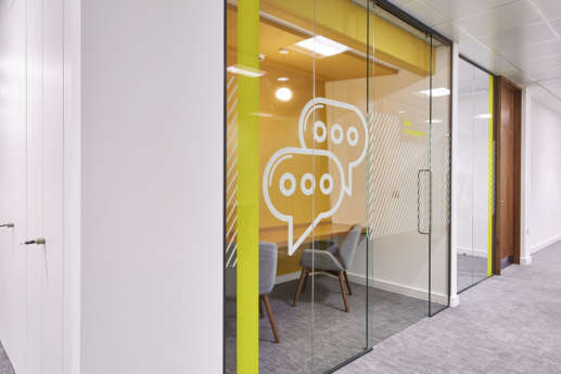 Two person meeting room with glass wall