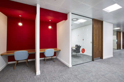 Fit out with solo desks with red highlights