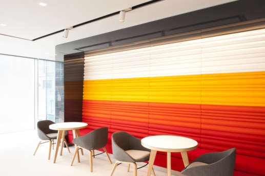 Red, yellow and white wall in office cafeteria