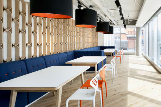 Bright office cafeteria with wooden flooring