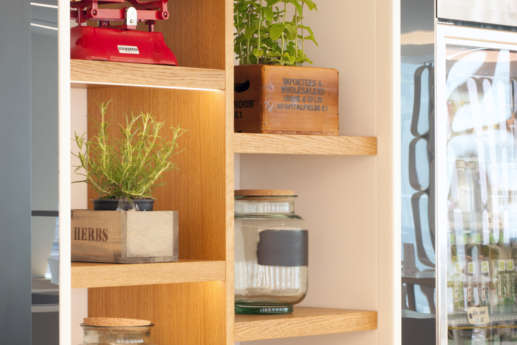 Bookshelf with plants in modern office fit out
