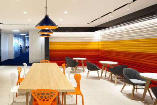 Office cafeteria with designer seating and coloured walls