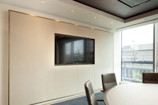 Meeting room with recessed wooden ceiling