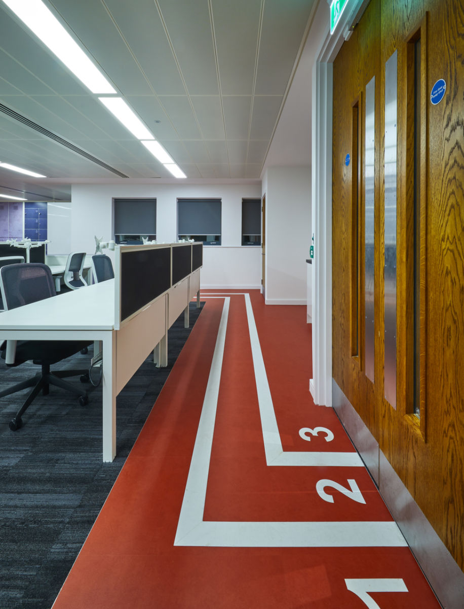 Running track behind office workstations
