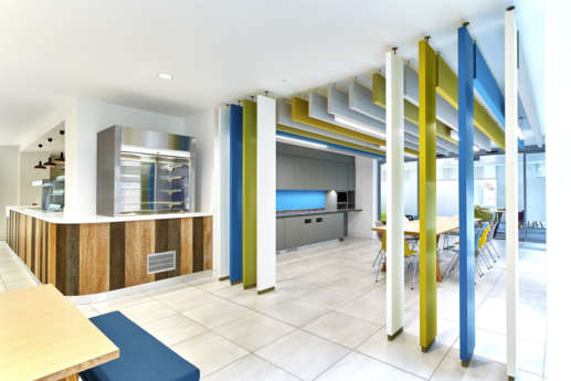 Modern staff cafeteria with coloured wall panels