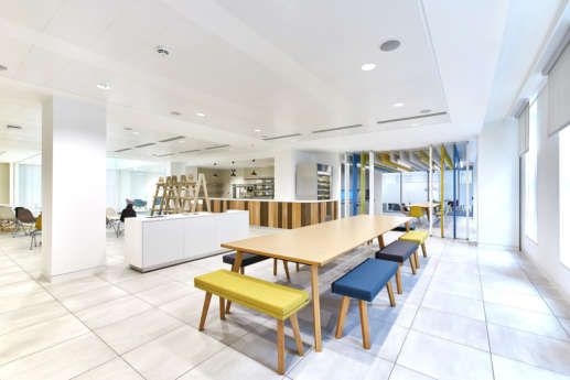 Colourful booth seating in office kitchen
