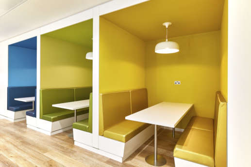 Yellow and green office booth seating