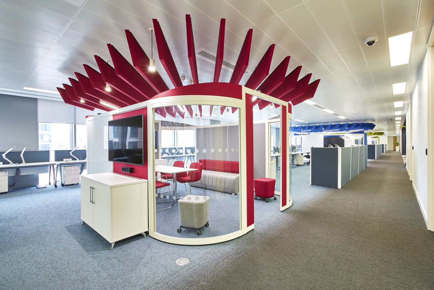 Office meeting pod with red felt paneling