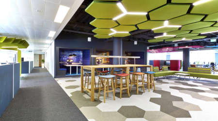Office breakout space with colourful furniture