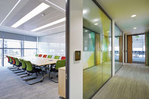 Office boardroom with orange and green chairs