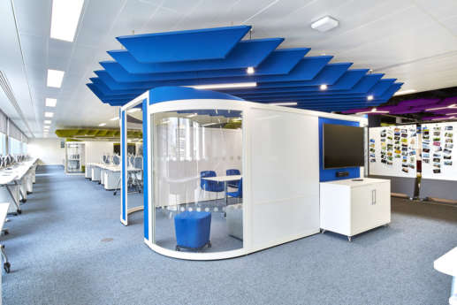 Blue ceiling rafts over office meeting pod