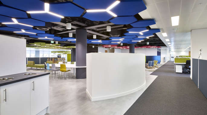 Office with floating blue hexagonal ceiling panels