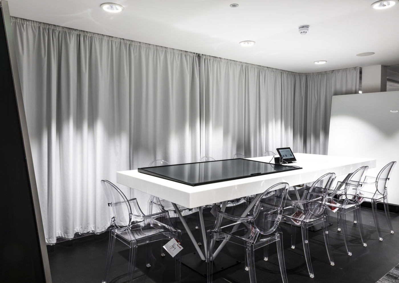Meeting room with large built-in touchscreen desk